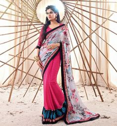 """Bollywood is one of the greatest factor influencing Indian Fashion. Get this Exciting  Saree from the Movie """"Holiday"""" featuring """"Akshay Kumar"""" and """"Sonakshi Sinha"""" in lead roles. This Saree is created from Pink Georgette material and has lovely Print & Zari Border Work."""