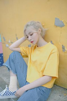 Sporting a simple solid color and a boxy silhouette, this cropped t-shirt is a casual but trendy piece. It has a classic crew neckline, elbow-length sleeves, and a comfortable loose fit. You can pair it with high-waisted jeans or layer it under suspender