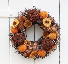 cinnamon, anise,dried oranges, pinecone and twig wreath