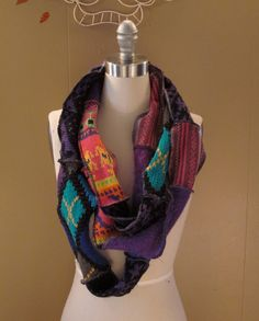 """Recycled Sweater Scarf: Mixture of sweater scraps with complementing colors. The mobius scarve is long enough so that you can really play around with how you'd like to wear it and how many times you'd like it to wrap around your neck or shoulders.  4"""" wide and the circle is 125"""" around. Make your own or click picture to order."""