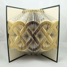 Folding pages of a book.