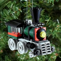 Emerald Express Christmas Ornament is built with LEGO® elements and glued together with a fishing wire hanger. Approximate size: (l) x Lego Christmas Ornaments, Christmas Paper Crafts, Christmas Projects, Christmas Stuff, My Builder, Lego Craft, Lego Trains, December Holidays, Lego Group
