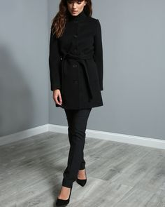For cool mornings and late nights, our tailored cashmere and wool coat has you covered.   The Owenea features a black mouflin wool, a Liberty of London lining panel in the funnel neck, a detachable belt, and concealed pockets.