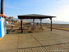Shaded picnic area and changing facilities Lead The Way, Water Me, Seaside Towns, Picnic Area, Malaga, Gazebo, Outdoor Structures, Warm, Beach