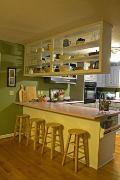 12 Easy Ways to Upgrade Basic Kitchen Cabinets Want to give your outdated or builder-grade kitchen cabinets a fresh new look? Try these easy, low- Basic Kitchen, Green Kitchen, Kitchen On A Budget, Updated Kitchen, New Kitchen, Narrow Kitchen, Kitchen Racks, Neutral Kitchen, Kitchen Updates
