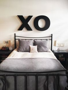 XO over the bed. Link goes thru this woman's whole apartment. I love her style!!