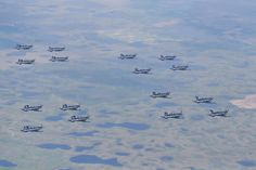 A rare Harvard II 16-ship formation flies over 15 Wing Moose Jaw, Saskatchewan. PHOTO: DND