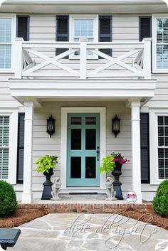 Front door paint color: Benjamin Moore Grenada Villa 690