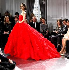 Christian Dio Haute Couture - Spring/Summer 2012. I love the expressions on the audience members' faces. Especially the girl on the right, with her head slightly tilted.
