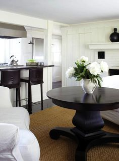 Suzie: New England Home - love the contrast of the dark wood with the white slipcovered furniture