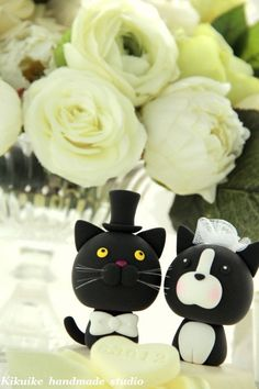 Wedding cake toppers for the cat lovers!  Holy crap, those are my cats...just, backwards. :)