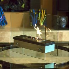 Bluworld Ardore - Bio-Fireplace. Bluworld NF-F2ARE - Ardore - Bio-Fireplace Italian for fiery passion, this elegant fireplace lives up to its name. A large capacity stainless steel burner is capped with a sleek black cover drawing attention to the dancing .. . See More Table Top Fireplaces at http://www.ourgreatshop.com/Table-Top-Fireplaces-C1031.aspx