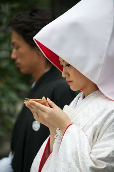 A popular Japanese wedding tradition is the sake-sharing ceremony, san-san-kudo, which dates back to the eighth century. During the ceremony, the bride and groom each take three sips of sake from three stacked cups.  Their parents then also sip from the cups. The sake ceremony creates a symbolic bond between the couple and their families.