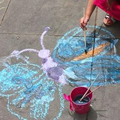 Take outdoor chalk creations to the next level by handing them a paintbrush and a cup of water.