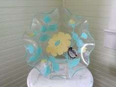 Your table deserves this deliciously flowing bowl of exceptional quality!  I T E M -- Glass serving bowl with scalloped edges and fused flower designs.  M A N U F A C T U R E R -- Appleman Art Glass, Hackensack New Jersey  C O L O R S -- Yellow and turquoise on clear glass  M E A S U R E M E N T S -- 11 1/2 w x 3 h  W E I G H T -- 1 pound 13 ounces  M A T E R I A L S -- Glass  C O N D I T I O N -- Wonderful! This glass bowl is used and in good vintage condition. No chips or cracks. Good ...