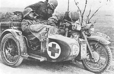 A BMW R75 with a very tired medical team resting.