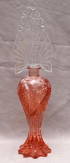 Tall pink Czech cut glass perfume bottle with cut