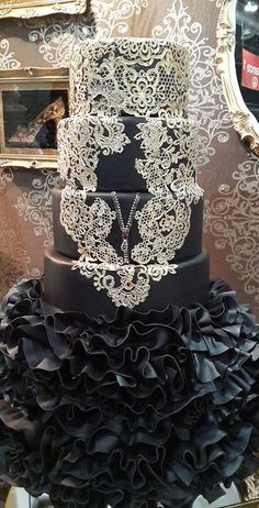 This beauty is created using various molds from our collection. Create stunning cakes like this and more. Find us at: www.allaboutcakeart.com