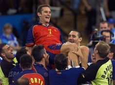 The Duke of Palma de Mallorca Inaki Urdangarin is lifted up by his teammates as they celebrate their 26-22 victory over Yugoslavia in the men's handball final for the bronze medal at the 2000 Sydney Olympic games ©Odd Andersen (AFP/File)