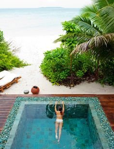 Soneva Fushi resort, Maldives Contemporary pool with large format pool tile and pebbles around outer edge. Pinned to Pool Design by Darin Bradbury.
