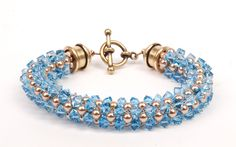 Free cubic right-angle weave instructions by Tammy Honaman. Weave this 3-dimensional, sparkling crystal and pearl bracelet, today at BeadingDaily.com.
