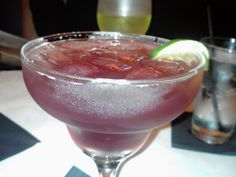 Patron raspberry margarita. Patron tequila, chambord, lime juice, sour mix, shake it to wake it, pour and consume.