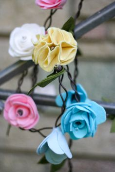 May Flowers - Felt Flower Garland Lights... now I know what to do with all of those felt flowers!