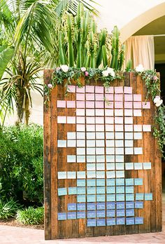 Brides: Ombre Escort Card Wall. Create this cool, carefully planned ombré look for your own escort card display by arranging cards in an array of shades from light to dark like Prim and Pixie did here.