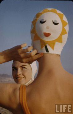 60s swimming fashion. S) Bathing caps, made of rubber. Couldn't get those hairdresser locks wet. Had friends/adults who went weekly to get hair done.