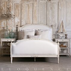 """Dauphine Queen Bed in Weathered White Eloquence® Dauphine Queen Bed with elegant Swedish arching frame. Hand-finished in our Weathered White and upholstered in White Linen. Footboard height is 33.5"""". 10 yards to re-upholster. Also available as a heavenly Canopy bed and in our Beach House Natural finish with Fog Linen upholstery. King size available as well."""