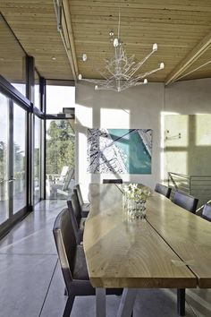lighting / chandelier & like that table too --  Stinson Beach House: Great Combination Between Modern Detailing and Rustic Materials