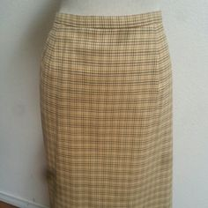 """Authentic Burberry Nova Check Skirt Excellent condition knee length skirt in the tan nova check signature pattern. Darted waist with a back button & hidden zipper close & a back slit for comfort & style. Fully lined. Waist 14"""" laid flat & 24"""" long.💥💥THE SPOTS ARE FROM MY CAMERA, NOT ON THE SKIRT!!!💥💥 Firm... Burberry Skirts Midi"""