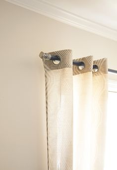 This DIY curtain rod is made of a dowel rod decorated with a cabinet knob. There are nearly unlimited possibilities to match your decor with the many cabinet knobs you could choose for these curtain rods. See the simple tutorial on The Home Depot Blog.
