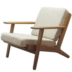 Hans J. Wegner GE 290 Lounge Chair | From a unique collection of antique and modern lounge chairs at https://www.1stdibs.com/furniture/seating/lounge-chairs/