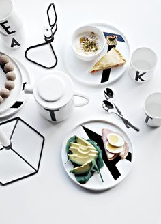 Beautiful styling by Only Deco Love. Design Letters plates, cups and teapot with typography by Arne Jacobsen. Black and white