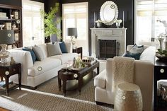 gorgeous! Dark accents, white couch, blue pillows....lighter floors.