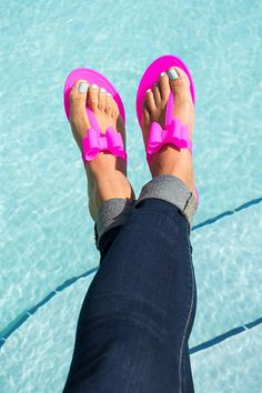 Polish up your poolside look with these chic, bow-topped jelly flip flops! Gorgeous Bright Colors and Classic Nude & Black for everyday wear.