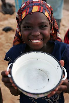 a young girl smiles for the camera in Chad, Africa where Good Neighbors is building new water wells for her village