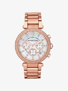Turn your attention to the Parker: this sleek and chic timepiece is trimmed with sparkling pavé stones for an elegant, uptown sensibility. The brushed stainless steel bracelet and round face—accented with iridescent mother-of-pearl—make for a timeless design, while sparkling pavé embellishments add a glamorous touch. Wear this feminine watch with everything in your closet, from a simple knit and jeans to a sexy cocktail dress.