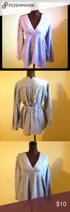 Free People Hobo Tunic Size Small Free People Tunic. Ties in the back. Size Small but runs pretty big. There are a few stains on the front (pictured) with one small stain on the right chest (I ran out of room for pics). If you love Free People and don't mind the wear, it's a great deal! Free People Tops Tunics