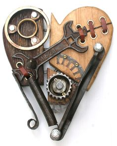 Assembled recuperated Wood and metal sculpture. The wood is cut from an old barn door then lovingly brought back to life in the form of a steam punk heart. One off original. Wood And Metal, Metal Art, Rusty Metal, Wood Art, Steampunk Accessoires, Sculpture Metal, Found Object Art, Junk Art, Assemblage Art