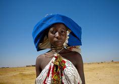 Mucubal woman - Angola . http://kwekudee-tripdownmemorylane.blogspot.co.uk/2012/12/mucubal-people-angolan-enduring-tribe.html