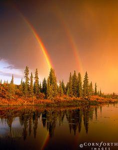 Stormy Double Rainbow Sunset by Jon Cornforth
