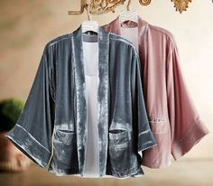 Luxuriously silky, our Vintage Silk velvet Kimono has a beautiful open front and handy welt pockets. Three-quarter sleeves and a longer in the back hem. Layer it with a tank, cami, or even a long sleeve knit top.