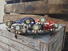 Our Vintage watch Bracelets are made of 3 leather straps and a braided leather strap. It has two snaps to fit anyone's size wrist perfect. Each watch has beads and a leaf charm. Compliments any wrist. A great accessory to add to any wardrobe. we have 6 color options