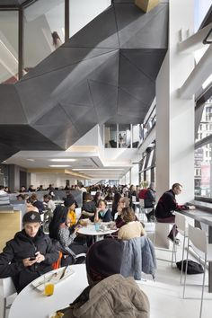 Image 17 of 34 from gallery of The New School University Center / Skidmore, Owings & Merrill. Photograph by James Ewing New School University, University Center, Parsons New York, Parsons New School, Concrete Staircase, The New School, Future School, Dream School, Student House
