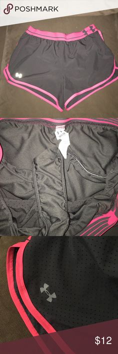 Under Armour Shorts Size Medium Excellent condition. Fits true to size. Dark gray and hot pink. Super cute. Has liner. Lowest offer is the price listed. No trades or Mercari. Price firm unless bundled. Under Armour Shorts