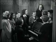 "Adeste Fideles in the film ""The Bells of Saint Mary's""  Father O'Malley (Bing Crosby) and the children at choir practice."