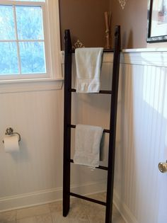 An old playground ladder reclaimed into a towel rack for our powder room!