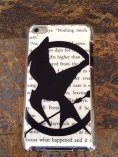 how to make this case: Things you'll need: Clear iPhone, iPod, iPad, case, hunger games book, a cut out of the mocking jay, clear tape or glue. 1st~ Get your book, and cut out your favorite page, then measure it to the size of the case. then use your clear tape or glue, and tape or glue it to the case (on the inside). 2nd~ Then get your mocking jay cutout and glue it to the outside. Now your finished!!